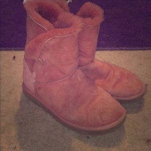 Pink ugg boots with wear but pink lining inside